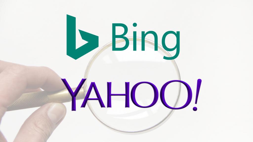 lupa con logotipos de bing y yahoo
